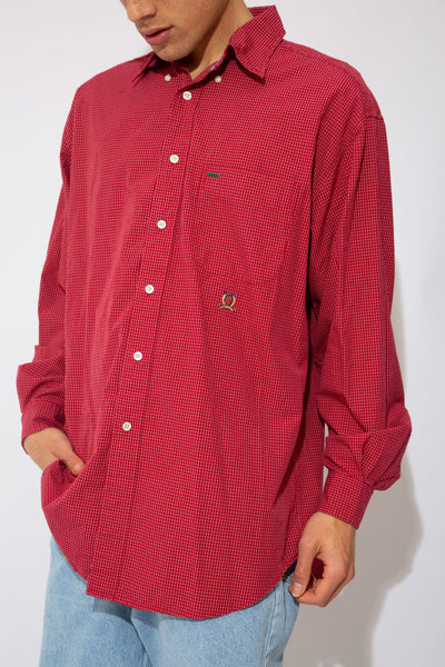 red and white checked button up with embroidered crest below left chest pock