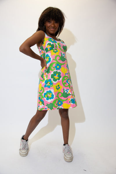 Brightly coloured in pink, green, white and blue in a large 70's style floral pattern, pair this cute as hell dress with Airforce 1s for a laidback summer fit!