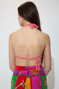 Bright pink in colour with an adjustable tie-up halter neck and bikini- like strap.