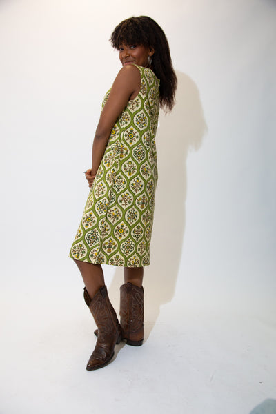 With its green colours, circular patterns and a-line fit, this dress would look cute with Airforce 1s!