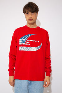 red longsleeve with front and back text and logo graphic, aswell as spell-out down left sleeve