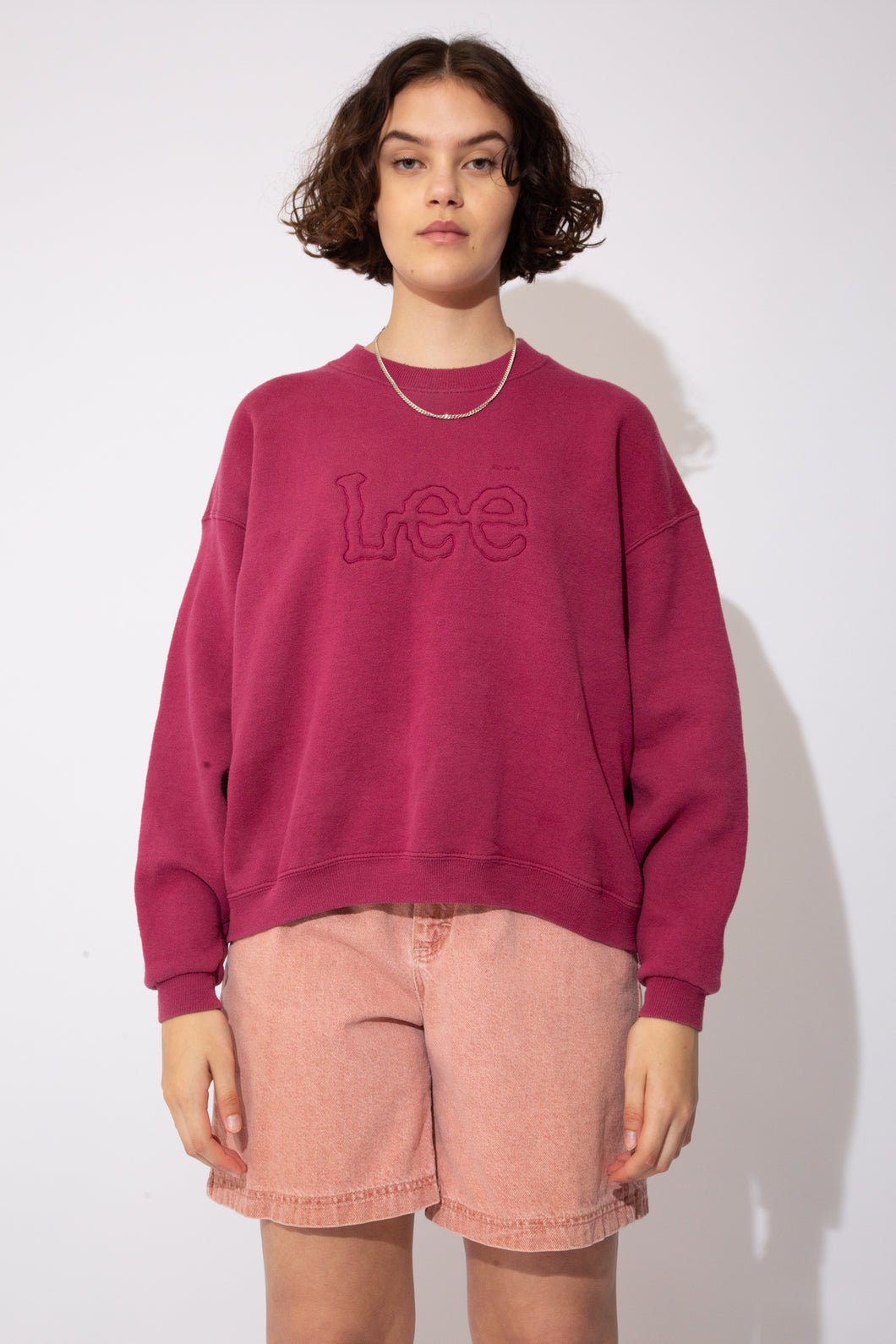 Maroon sweater with 'Lee' outlined and embroidered into the material across the chest. Ribbed neckline, waistline and sleeves add to baggy fit!