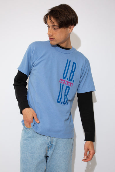 faded blue tee with 'U.B what U.B' text graphic on front and 'I.B. Dancing' on back