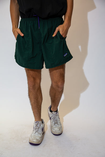 Dark green in colour, these shorts are in a togs material with an adjustable waistband, pockets and Patagonia branding on the left leg.
