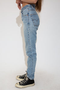 These Levi Strauss Jeans are light-wash blue in a slim fit with a tapered leg and distressing on the right leg.