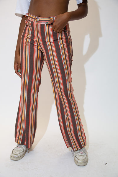 the model wears flared pants with a striped pattern