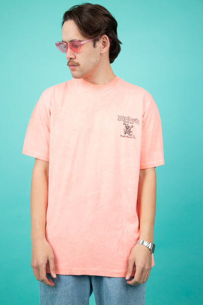 Bright pink tee with bluebeards small graphic on front and large backprint. magichollow