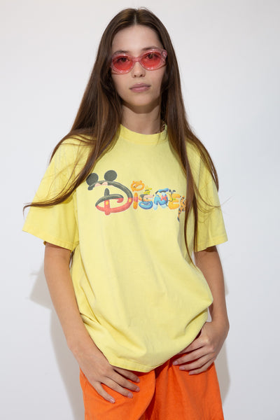 Yellow in colour with a large Disney spell-out in the shapes and colours of Disney characters on the front.