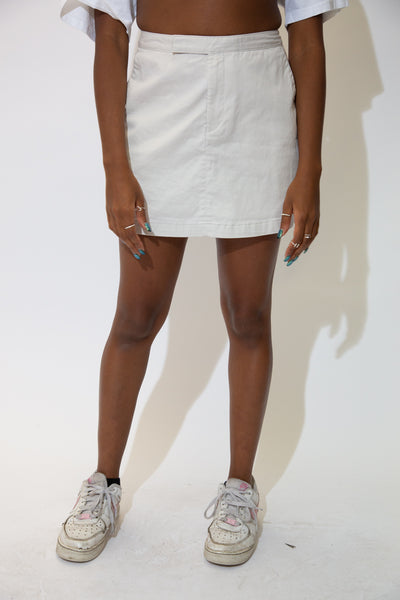 the model wears a cream coloured stretchy skort