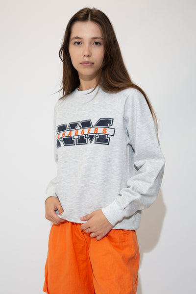 Grey in colour with a crew neck style and NM Chargers printed across in navy blue and orange.