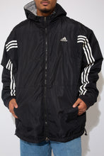 Load image into Gallery viewer, adidas jacket in a black and white colour-way. small embroidered adidas logo on the left side of the chest. 90s vintage. magichollow.