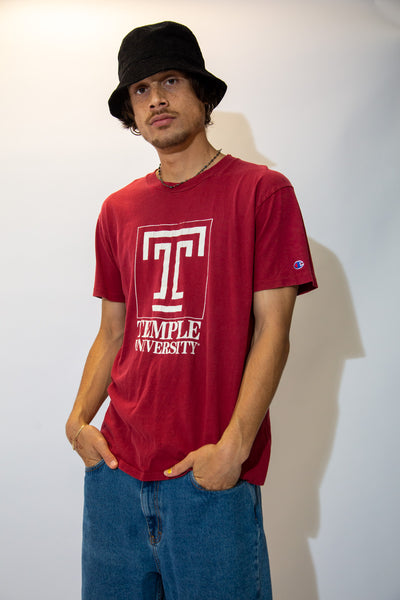 Red in colour, this single stitch tee has a large white print of a capitalised T, Temple University printed below and Champion branding on the left chest.