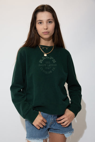 Dark green in colour with a faded print on the front repping Ralph Clothing Co and the establishment date 1967 in a circular design.