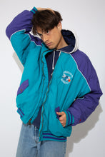 Load image into Gallery viewer, warm oversized bomber in iconic charlotte hornets colourway with embroidered and patch detailing on chest, sleeves and back