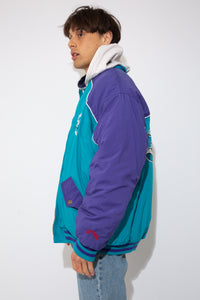 warm oversized bomber in iconic charlotte hornets colourway with embroidered and patch detailing on chest, sleeves and back