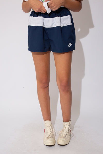nike shorts in navy and blue colour-way. 90s vintage. magichollow!