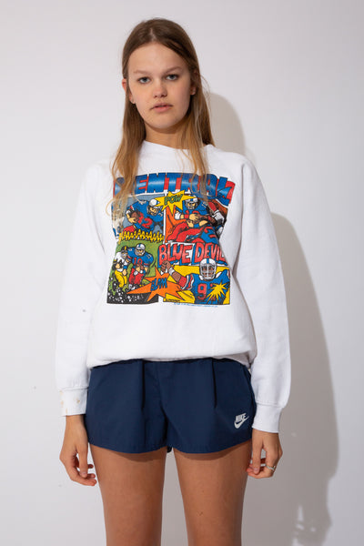 white crewneck with Blue Devil's American Football comic on the front