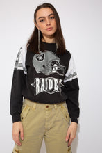 Load image into Gallery viewer, model wearing raiders sweater, magichollow