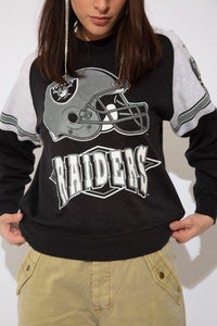 model wearing raiders sweater, magichollow