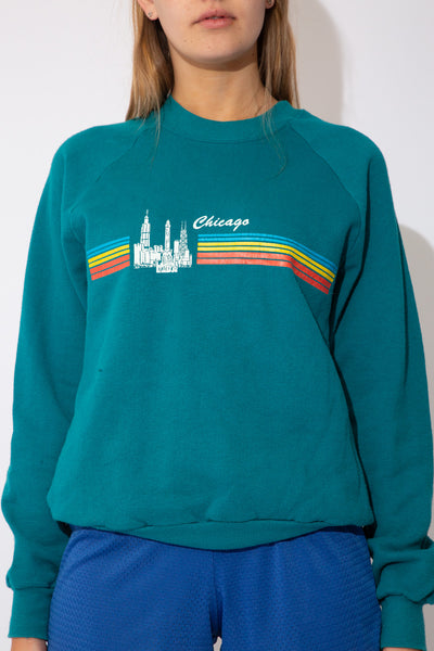 teal blue sweater with chicago graphic on the front