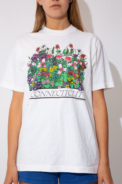 white tee with flowers all over the front and the text connecticut