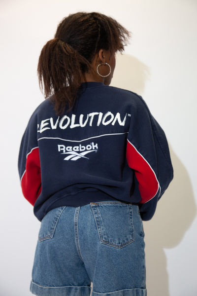 the model wears a reebok sweater