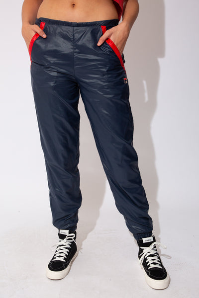 navy blue trackpants from fila with red detailing