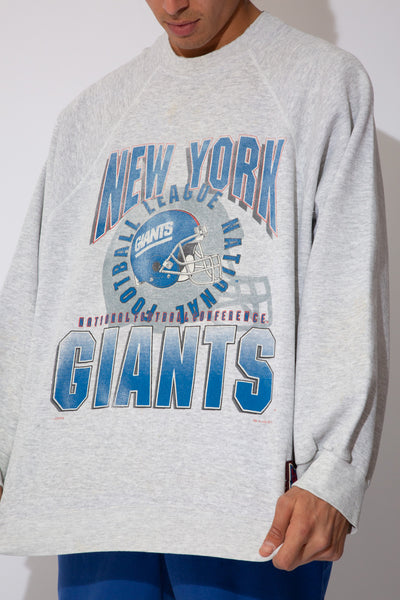 grey marle sweater with large faded ny giants spell-out and logo graphic