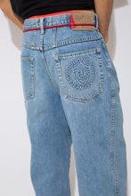 Load image into Gallery viewer, mid-wash baggy-to-tapered-fit jeans with embossed union bay logo detail on back right pocket
