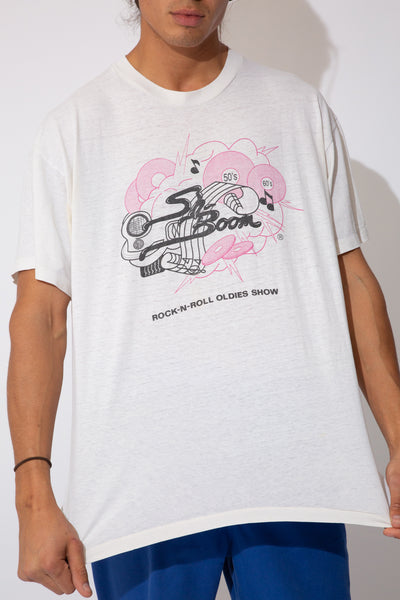 thin white tee with pink toned music graphic on front