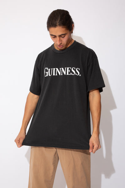 faded black tee with guinness spell-out across chest