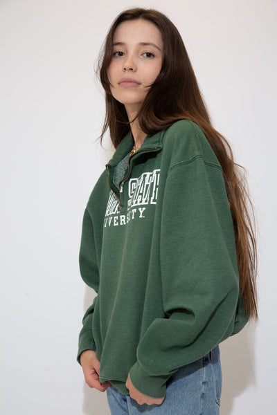 Green in colour with a quarter-zip style, turtle neck neckline and a white outlined print of 'Wright State University' across the front.