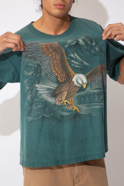 textured teal/green tee with large faded eagle graphic across front