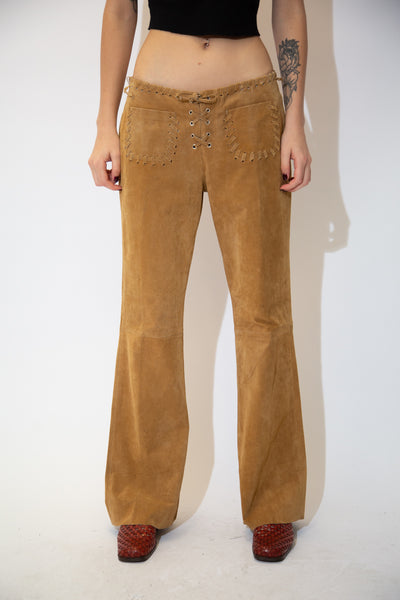 With their tan colour, flared leg fit and soft suede feel, these old school pants are finished off with lacing around the waistline, down the zipline and on the front pockets.