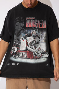 black oversized tee with ice hockey graphic featuring buffalo sabres goalie dominik hasek