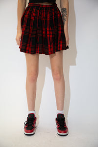 Red and black plaid skirt in a pleated style.