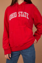 Load image into Gallery viewer, This Tommy Hilfiger must-have is red with 'Ohio State' in a grey appliqué on the front. Ribbing on the side adds to the fitted shape. TH logo on the sleeve with a kangaroo-pouch pocket and a hood.