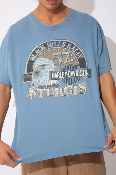 faded blue tee with harley davidson graphic on front and back from the 1997 sturgis rally