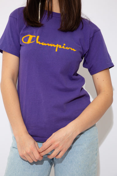 model wearing champion tee, magichollow
