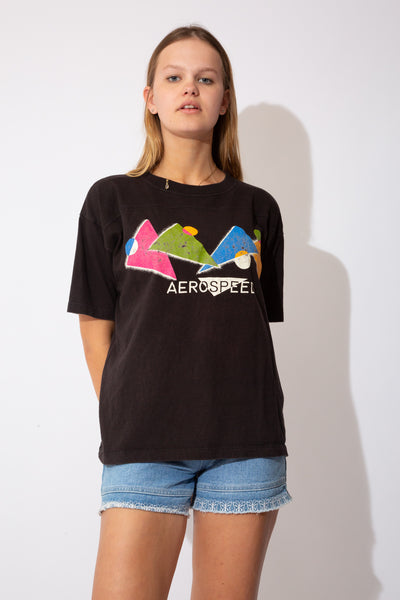 black tee with funky graphic on front in lots of colours