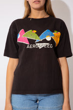Load image into Gallery viewer, black tee with funky graphic on front in lots of colours