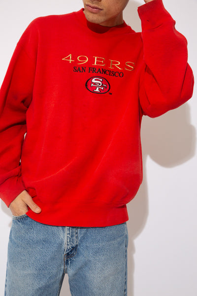 Red crewneck sweater with 49ERS Embroidery on the front. vintage clothing at magichollow