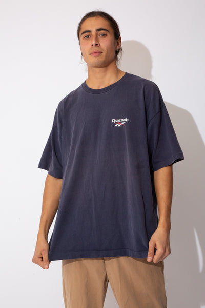 faded navy tee with small reebok logo left chest and large USA spell-out across back and shoudlers
