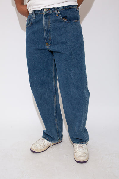 polo jeans co jeans in a mid-washed colour-way. 90s vintage. magichollow.