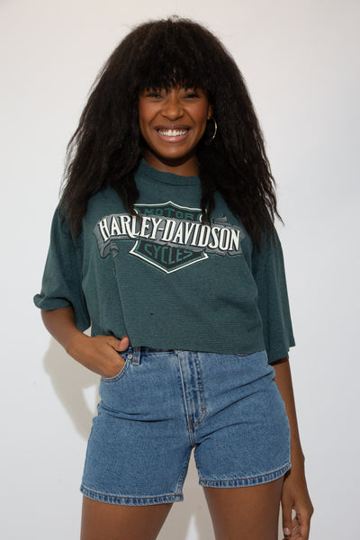 textured dark green cropped tee with large harley spell-out logo graphic on chest and back graphic