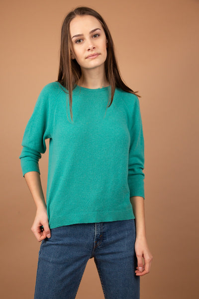 Soft cashmere sweater with three-quarter length arms. Coloured in teal and cosy in feel. Has signs of distressing along the neckline.