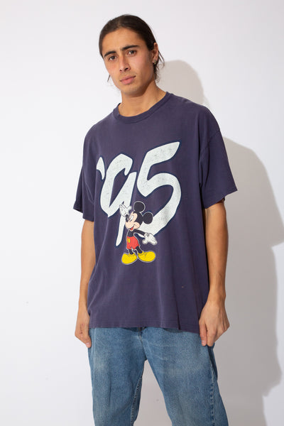 faded navy tee with 95' and mickey graphic on front and large 'walt disney world' spell-out across back