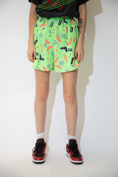 Neon green in colour with an abstract colourful print across them, these shorts have an adjustable waistband and a hella cool aura!