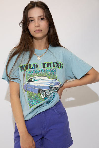 Light blue single-stitch tee with a large colour car print on the front, a 'bad thing' spell-out' and '1956 Cadillac' printed below.