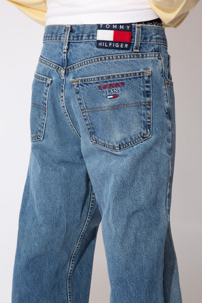 faded mid/dark-wash baggy-to-straight fit jeans with tommy jeans embroidery detail